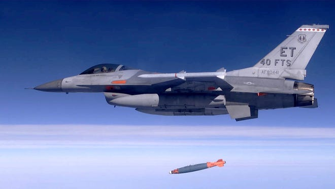An F-16 drops a JDAM-equipped bomb flying over Eglin Air Force Base in this April 18, 2002 file photo. The Joint Direct Attack Munition, or JDAM, became the most widely used air-delivered weapon of the war on terrorism in Afghanistan because of low cost, high accuracy and all-weather capability.