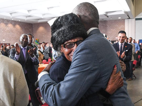 Hattie Estella Williams, left, gets a hug from Anderson Mayor Terence Roberts as he honored her with the Trailblazer award on Friday at the Mayor's Martin Luther King, Jr. Breakfast at the Civic Center of Anderson.