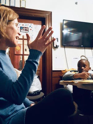 Dr. Heather Boxerman tutors a child at a Brockton shelter run by the Old Colony YMCA . She and her family volunteered their time at the shelter for four years through the School on Wheels Massachusetts organization.