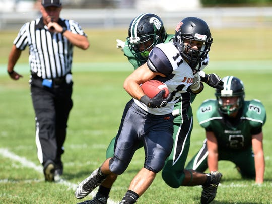 Marlboro's Tanner Harshberger breaks free from Spackenkill's Andres Blanco during a 2015 football game .