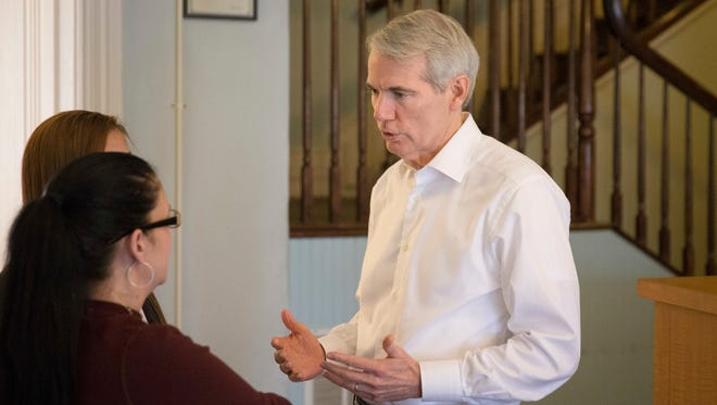 U.S. Sen. Rob Portman, R-Ohio, right, speaks with treatment residents as tours the First Step Home, a women's drug addiction treatment facility, Monday, May 16, 2016, in Cincinnati. The facility permits children up to the age of 12 to remain with their mothers during their treatment stay.