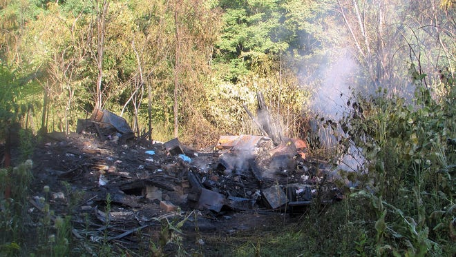 A vacant house in Lowman burned down late Monday.