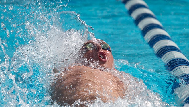 Gared Cosgrave of Lincoln Park Academy competes in the Boys 100 Backstroke during the 2016 FHSAA 2A Swimming and Diving State Championships on Saturday, November 12, 2016 at Sailfish Splash Waterpark in Stuart.