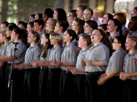 The Indianapolis Children's Choir performs during an anti-violence vigil at Monument Circle, July 12, 2014.