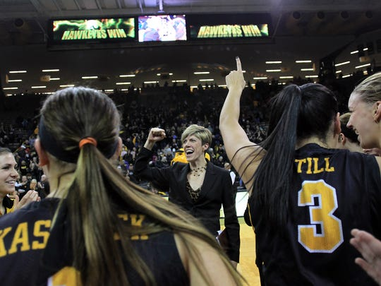 Iowa associate head coach Jan Jensen celebrates the Hawkeyes' 76-67 win over Iowa State at Carver-Hawkeye Arena on Thursday, Dec. 11, 2014.