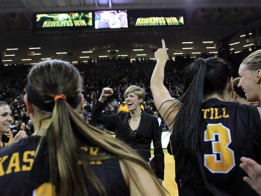 Iowa associate head coach Jan Jensen celebrates the