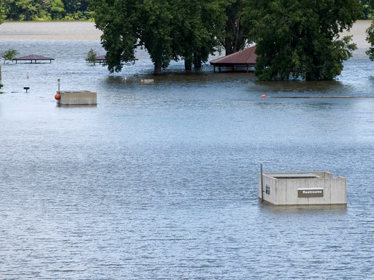 The Coralville Lake floods through the beach on Tuesday, July 8, 2014.