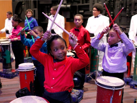 Dewaine Richards, 6, front, and Sydne Tolbert, 9, right, perform with the River City Drum Corps following the Keepers of the Dream celebration at the Kentucky Center for the Arts. Ed White, founder of the River City Drum Corps, received the 2015 Mayor's Freeom Award.   Jan. 18, 2015