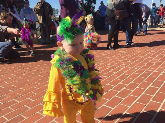 Hadleigh Walker, 15 months, was one of the youngest little miss Mardi Gras contestants Saturday at the downtown RiverMarket.