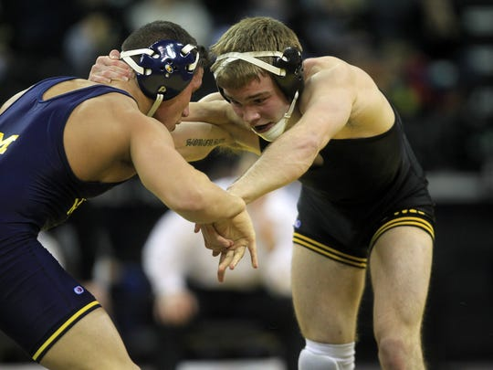 Iowa's Brandon Sorensen wrestles Michigan's Alec Pantaleo