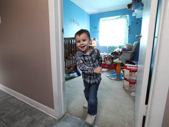 Wyatt Rewoldt, 2, is full of energy as he runs out