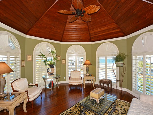12 Seashore Drive, the master suite sitting area with a high ceiling and a gorgeous view.