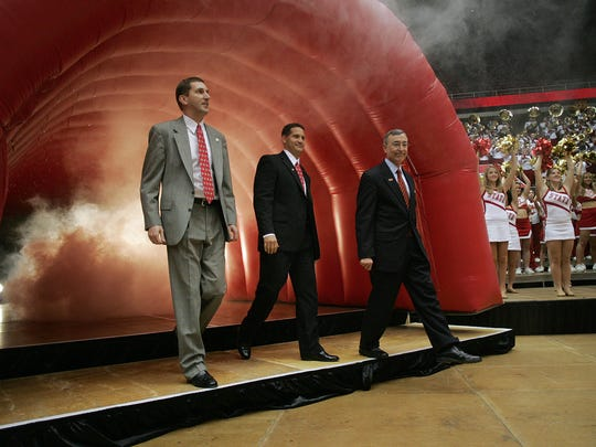 Fans packed Hilton Coliseum to welcome Gene Chizik when he was introduced as Iowa State's new coach back in 2006. Chizik walks out with athletic director Jamie Pollard and now former Iowa State president Gregory Geoffrey.