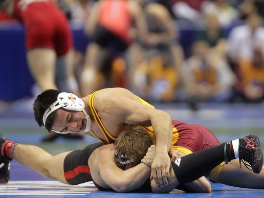 Iowa State's Michael Moreno wrestles Nebraska's Austin Wilson at 165 pounds during the first session of the NCAA Championships in St. Louis, Mo. on Thursday, March 19, 2015. Moreno lost by decision, 7-5.