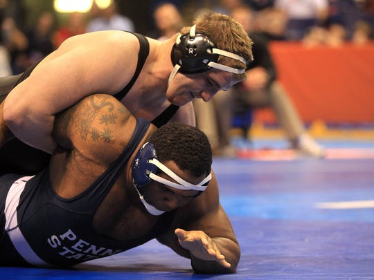 Iowa heavyweight Bobby Telford wrestles Penn State's James Lawson for for fifth place in the NCAA Championships at the Scottrade Center in St. Louis, Mo. on Saturday, March 21, 2015. Telford won by decision, 6-0.  David Scrivner / Iowa City Press-Citizen
