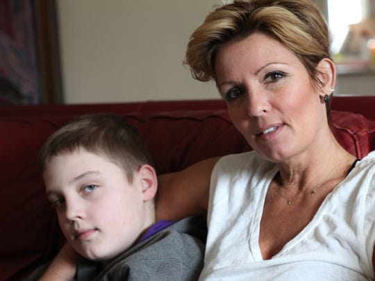 Sarah Donovan, 43, of Birmingham is upset her son, Michael Donovan, a sixth-grader, was asked by his school Friday to not return until April 14 for not being fully vaccinated for chicken pox.
