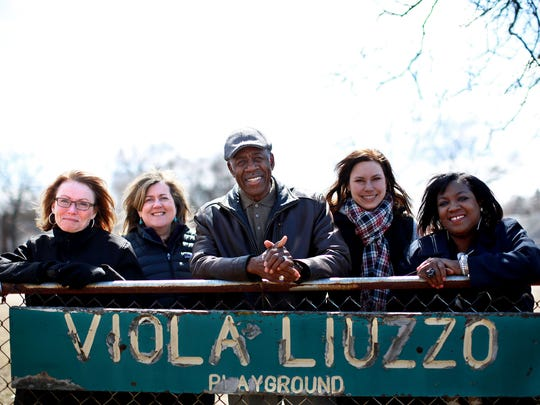 Colette Mezza, left, Julie Hamilton, Artis Johnson, Elizabeth Lamott Rutherford and Tracey Terrell, all members of the Viola Liuzzo Park Association, stand in the Detroit park that is named after the civil rights martyr.