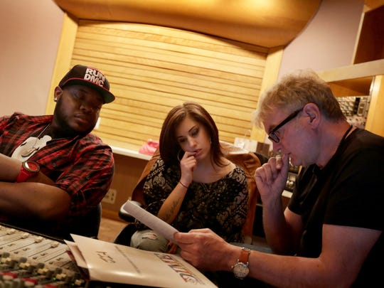 "Musician Brandon ""Showtime"" Bland, from left Artist Jena Irene and DIME executive Kevin Nixon rewrite lyrics during a recording session at Studio A in Dearborn Heights on Wednesday, April 15, 2015."