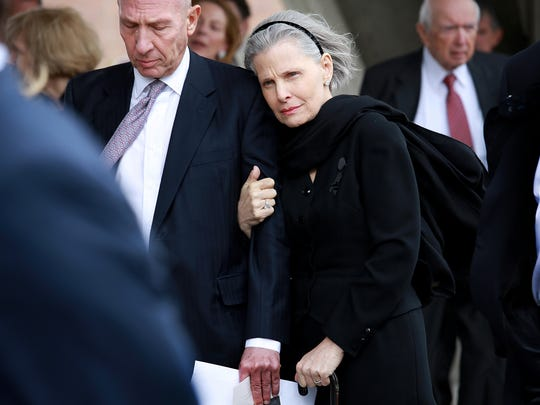 A. Alfred Taubman's daughter Gayle Taubman Kalisman watches as her father's casket  is placed in the hearse after his funeral service at Congregation Shaarey Zedek in Southfield on Tuesday, April 21, 2015.