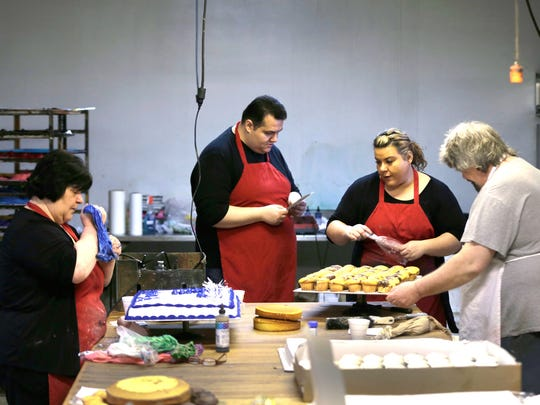 Janice Maksimovski, left, her son Christopher Maksimovski, her daughter Jasmina Wikenczy, all of Plymouth Township, and her brother Jim Acovski of Farmington Hills at work at Chene Modern Bakery in Detroit.