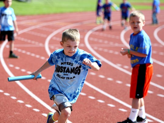 First-grade students race in the Country Kids Relays on Saturday, May 9, 2015.