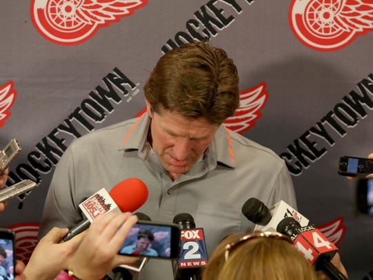Former Detroit Red Wings coach Mike Babcock talks to the media in the locker room at Joe Louis Arena in Detroit on Friday, May 22, 2015.