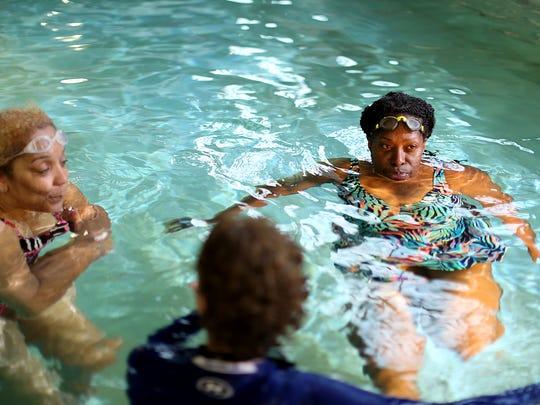 Cassandra Spratling, 59, of Detroit takes swim lessons at Detroit Boll Family YMCA in Detroit on Thursday, June 4, 2015.