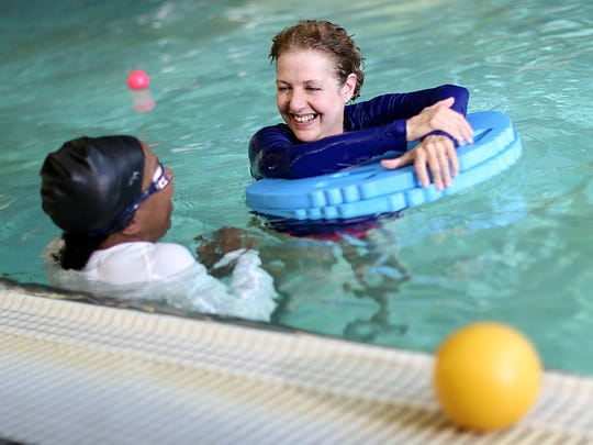 Swim Instructor Lori Trout, 59, of Detroit teaches at Detroit Boll Family YMCA in Detroit on Thursday, June 4, 2015.
