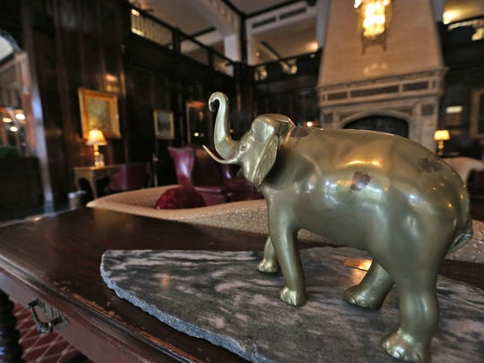 A statue of an elephant is in the lobby outside The Harrison Grille in the Columbia Club.