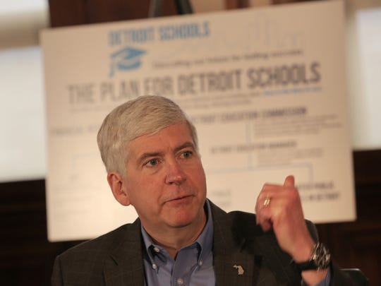 Michigan Gov. Rick Snyder talks about his proposal to restructure Detroit's public schools during a press conference at Cadillac Place in Detroit on Thursday, April 30, 2015.
