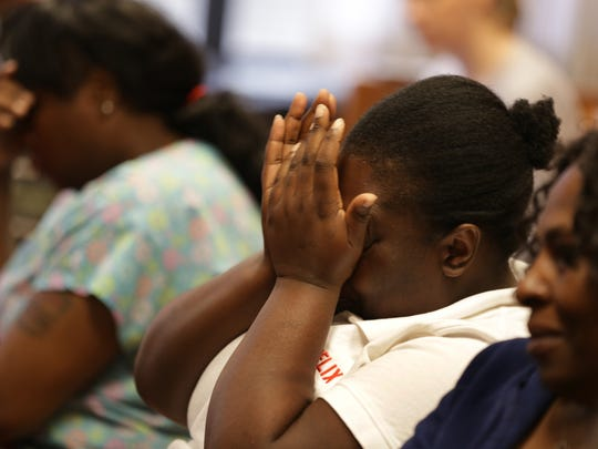 Friends and family of two children who were run over and killed by a car while playing on the sidewalk in front of their home in Detroit listen to the preliminary exam for Lorenzo Harris, also accused of injuring three children during the incident in front of Wayne County Court Judge Shannon Holmes at Frank Murphy Hall of Justice in Detroit  on Monday, July 13, 2015.