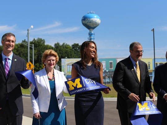 Left to Right, Ann Arbor Mayor Christoper Taylor, U. S. Sen. Debbie Stabenow Shauna Ryder Diggs, chairwoman of the U-M Board of Regents holding part of the blue Mcity ribbon after the ribbon cutting, UM President Mark Schlissel and Kirk Stuedel, director of  MDOT,  during the Mcity grand opening ceremony at the grounds of the University of Michigan in Ann Arbor Monday.