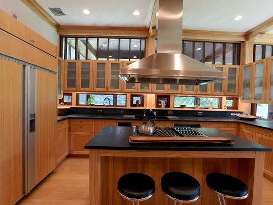 Soapstone counters and custom cabinetry in the kitchen.