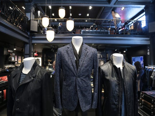 Menswear sits on display during the opening of the John Varvatos store in downtown Detroit on Thursday March 12, 2015.