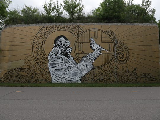 A mural by the Hygienic Dress League in the Dequindre Cut Greenway.