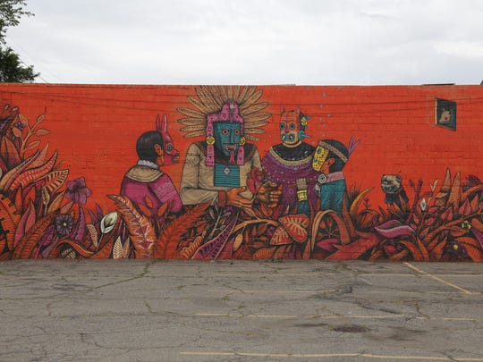 A mural by Saner on BeeBe's 2 market at  1421 Springwells in southwest Detroit on August 14, 2015.
