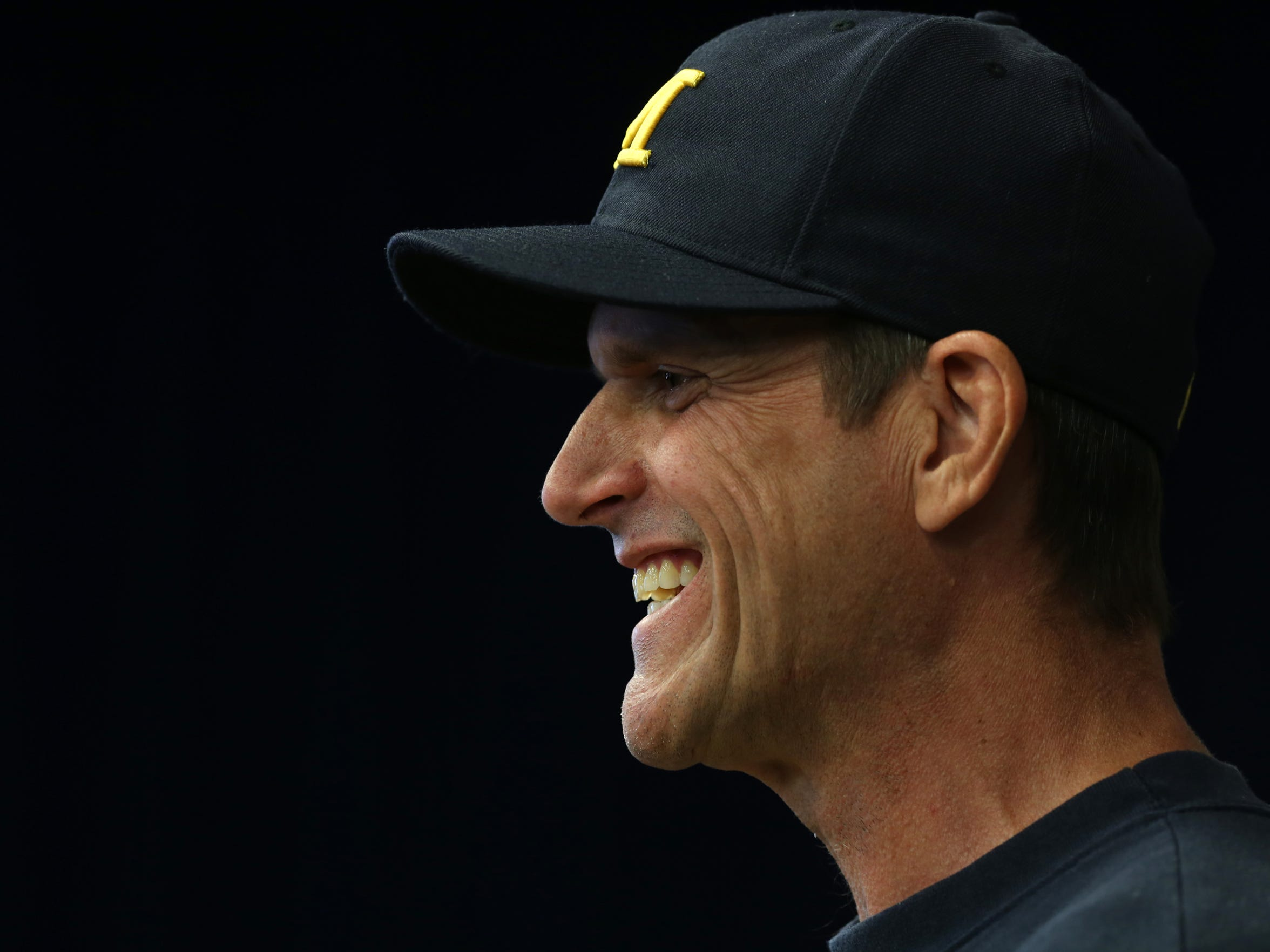 Aug. 27, 2015: Michigan head football coach Jim Harbaugh laughs with a member of the media during a question after his press conference at the Crisler Center Media Room in Ann Arbor.