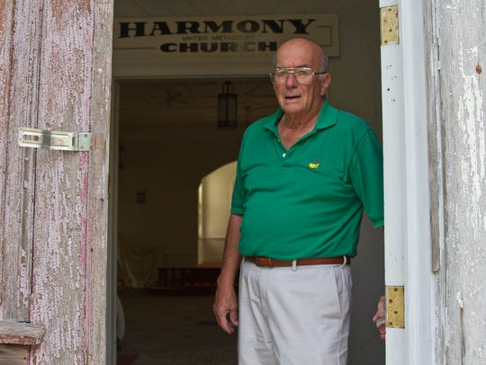 Church Elder Bruce Thompson stands in the church. The