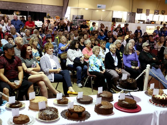 People watch the judging for the 56th annual Gerry Frank Chocolate Layer Cake Contest at the 150th Oregon State Fair in Salem on Sunday, Sept. 6, 2015.