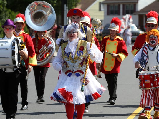 Members of the Funny Factory Clown Band march in the 58th annual Labor Day Parade, Monday, Sept. 7, 2015, in South Plainfield.