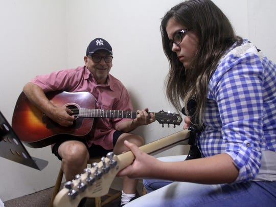 North Brunswick School of Music owner Mike DeFellipo plays guitar with student Alexis Faust, age 12, of Milltown, Thursday, September 10, 2015, in Milltown, NJ.