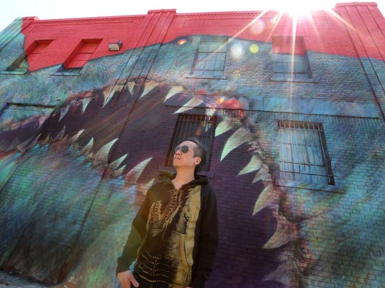 Shark Toof is a contemporary artist from Los Angeles, he was photographed in front of a mural he completed this on Division street at the Eastern Market.