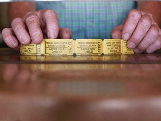 Tahqua-Land Theatre owner Fred Dunkeld shows tickets