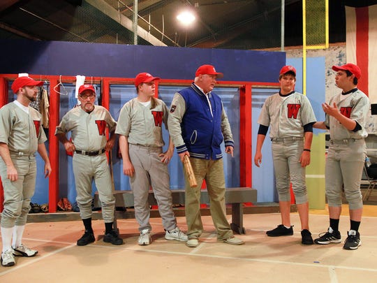"Actors rehearse a scene from ""Damn Yankees"" at the"