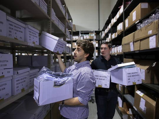 Steven Mazur, left, goes over inventory for his new start-up company, Ash and Anvil, with help from Robert Davison, Vice President of Operations at FulEx Logistics, an ecommerce fulfillment center  in Warren, Mich., on Friday, Sept. 18, 2015. Ash and Anvil will provide dress-casual apparel for short men who have trouble buying clothes off the rack.