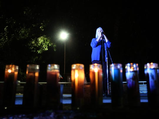Umpqua Community College President Dr. Rita Cavin speaks during a vigil at Stewart Park in Roseburg, Ore., on Thursday, Oct. 1, 2015. Students, families and supporters gathered after a shooting at Umpqua Community College.