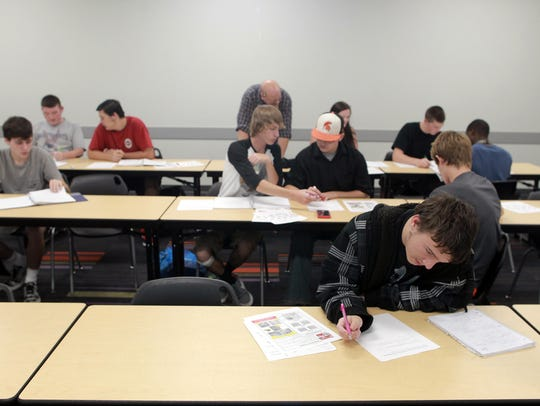 Students work on homework in their criminal justice