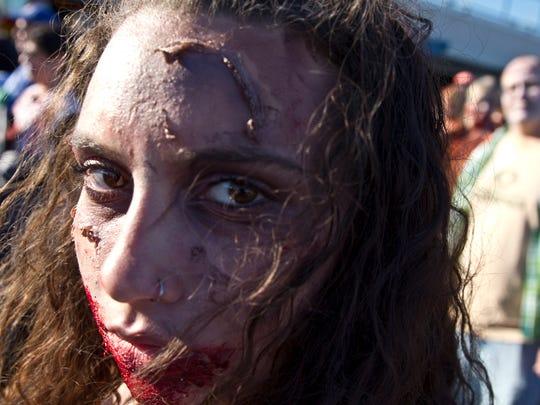 Josaphine Basile of Brick strolls down the boardwalk. The Zombie Walk heads down the Asbury Park Boardwalk late afternoon. Asbury Park, NJSaturday, October 10, 2015@dhoodhood