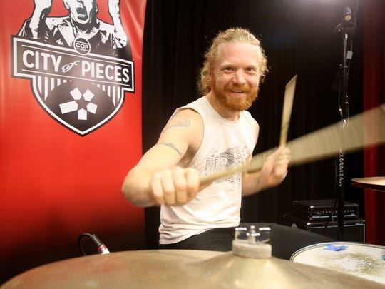 Drummer Doug Hoffman performs with City of Pieces at the CCTV studio on Sept. 4.