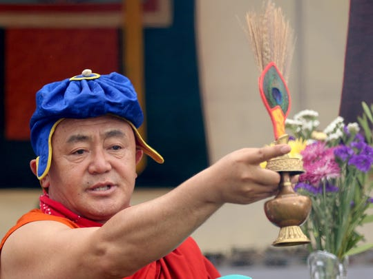Karma Namgye Rinpoche performs a sacred fire ceremony during the 18th annual World Beat Festival at Riverfront Park in Salem on Saturday, June 27, 2015.